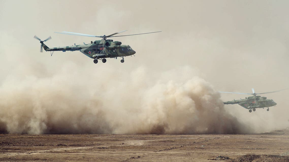 Russian Mi-8 military helicopters fly during the multinational military exercises Kavkaz-2020 at the Kapustin Yar training ground in Astrakhan Region, Russia September 25, 2020. Sputnik/Mikhail Klimentyev/Kremlin via REUTERS ATTENTION EDITORS - THIS IMAGE WAS PROVIDED BY A THIRD PARTY.