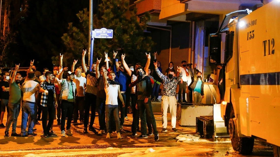 Pro-nationalist demonstrators gesture during riots against refugees in Ankara, Turkey, on August 11, 2021. (Reuters)
