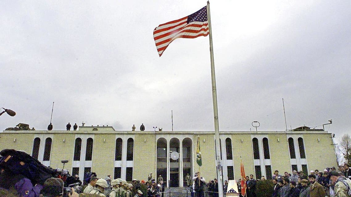 (FILES) In this file photo the American flag flies on a flag pole after it was raised at the opening ceremony of the US embassy in the Afghan capital of Kabul on December 17, 2001. The United States said on August 12, 2021 it was sending troops to the international airport in Afghanistan's capital Kabul to pull out US embassy staff as the Taliban makes rapid gains.We are further reducing our civilian footprint in Kabul in light of the evolving security situation, State Department spokesman Ned Price told reporters.This president prioritizes above all else the safety and security of Americans who are serving overseas, he said of Joe Biden, who has ordered a withdrawal of US troops from Afghanistan after nearly 20 years.