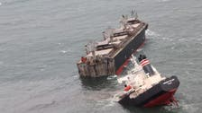 Ship snaps in two after running aground in northern Japan, crew safe
