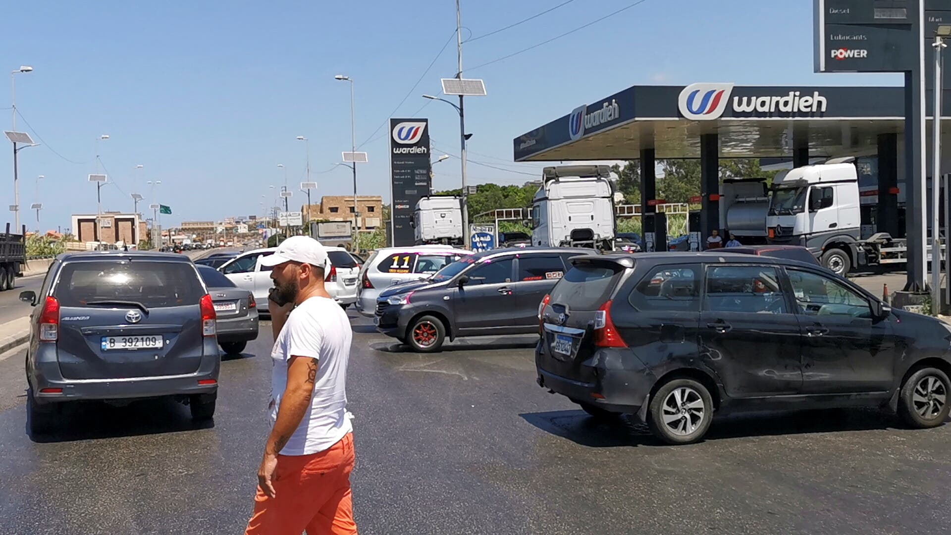 Cars block a road near a gas station in Sidon, Lebanon August 12, 2021. (Reuters)