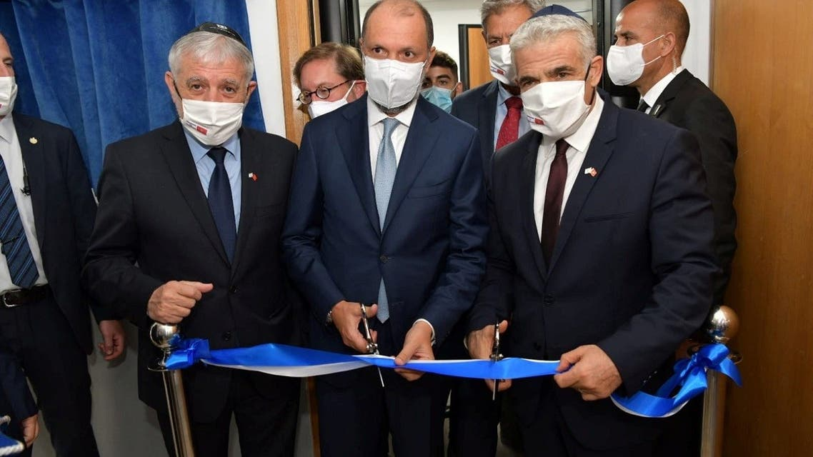 Israeli Foreign Minister Yair Lapid inaugurates Israel's diplomatic mission, in the presence of Minister Delegate to the Moroccan Foreign Ministry Mohcine Jazouli, in Rabat, Morocco August 12, 2021. (Reuters)