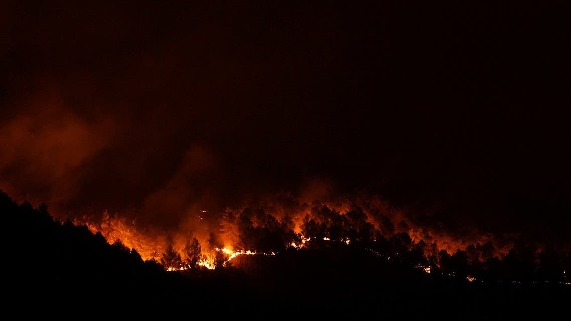 Fire rages in Giarratana, on the island of Sicily, Italy, on August 11, 2021. (Reuters)