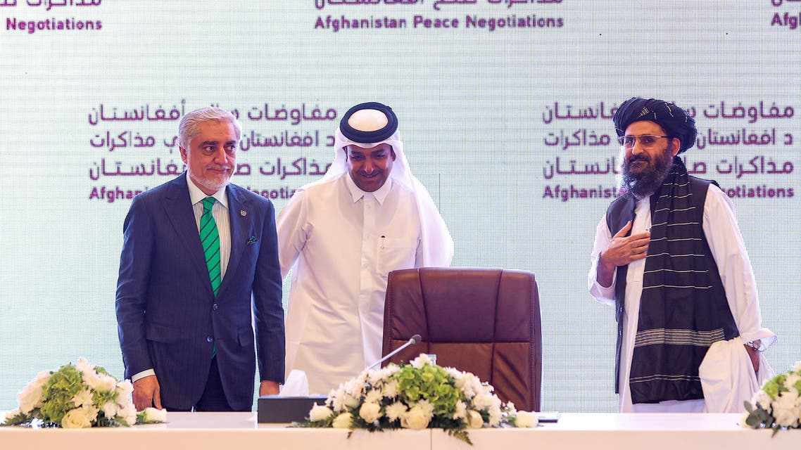 (L to R) The head of Afghanistan's High Council for National Reconciliation Abdullah Abdullah, Qatar's envoy on counter-terrorism Mutlaq al-Qahtani, and the leader of the Taliban negotiating team Mullah Abdul Ghani Baradar look on during the final declaration of the peace talks between the Afghan government and the Taliban in Qatar's capital Doha on July 18, 2021. Representatives of the Afghan government and Taliban insurgents held talks in Doha as violence raged in their country with foreign forces almost entirely withdrawn. The two sides have been meeting on and off for months in the Qatari capital, but the talks have lost momentum as the insurgents made battlefield gains.
