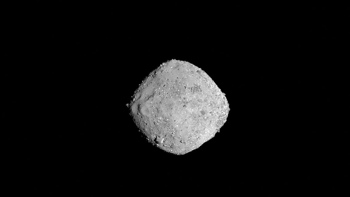 This November 16, 2018 photo from NASA's OSIRIS-REx spacecraft, obtained December 3, 2018 courtesy of NASA/Goddard/University of Arizona, shows the asteroid Bennu from a distance of 85 miles (136 km). The image, which was taken by the PolyCam camera, shows Bennu at 300 pixels and has been stretched to increase contrast between highlights and shadows. NASA's first-ever mission designed to visit an asteroid and return a sample of its dust back to Earth arrives on December 3, 2018 at its destination, Bennu, two years after launching from Cape Canaveral, Florida. The $800 million mission, known as OSIRIS-REx, is targeted for a 12 pm (1700 GMT) rendez-vous with the asteroid, and will use its suite of five science instruments to study the asteroid for the next year and a half.