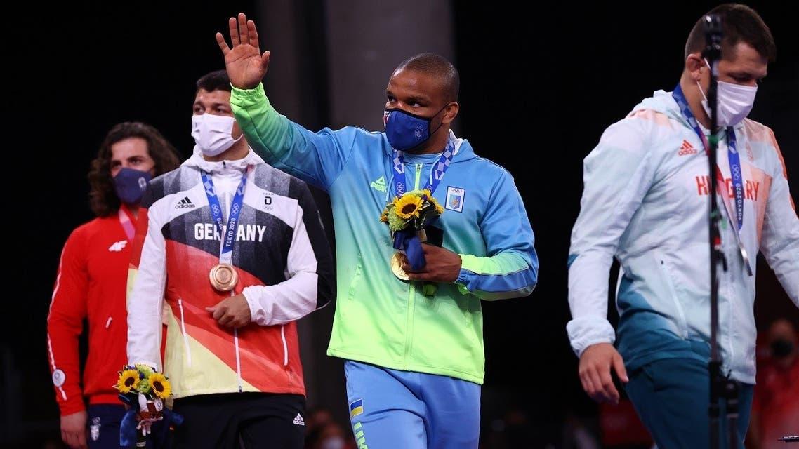 Gold medalist Zhan Beleniuk of Ukraine walks with silver medalist Viktor Lorincz of Hungary, bronze medalist Denis Kudla of Germany, and bronze medalist Zurabi Datunashvili of Serbia at the Tokyo Olympics on August 4, 2021. (Reuters)
