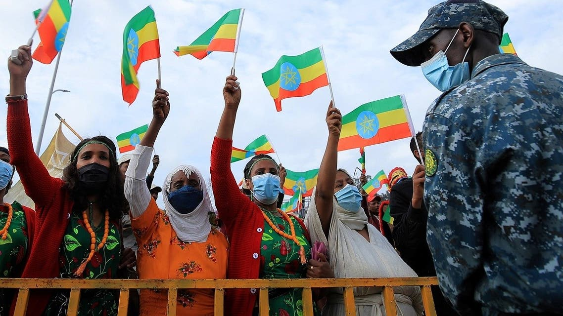 Women hold national flags during a rally to support the National Defense Force and to condemn the expansion of the Tigray People Liberation Front (TPLF) fighters into Amhara and Afar regional territories at the Meskel Square in Addis Ababa, Ethiopia, on August 8, 2021. (Reuters)