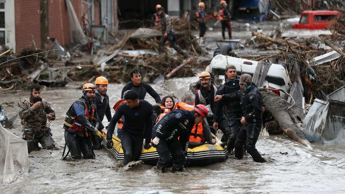 Search and Rescue team members evacuate locals during flash floods which have swept through towns in the Turkish Black Sea region, in Bozkurt, a town in Kastamonu province, Turkey, August 12, 2021. (Reuters)