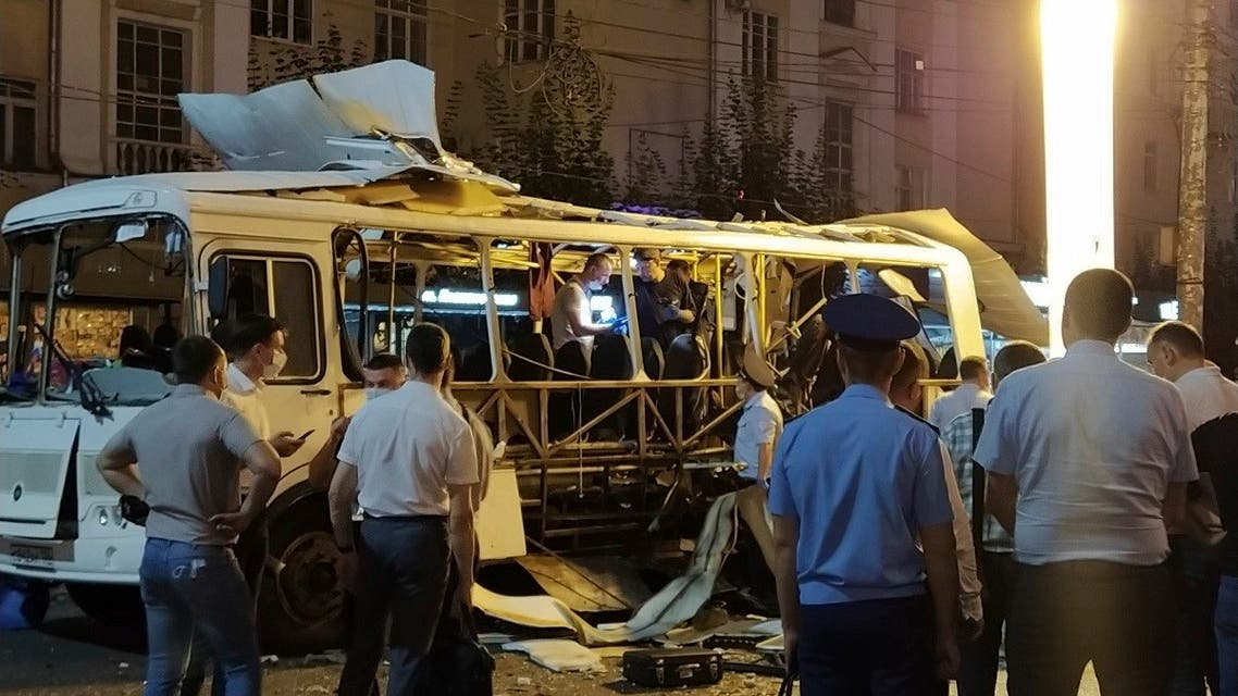 Police and investigators work at a side of an explosion on a city bus in Voronezh, about 450 kilometers (280 miles) south of Moscow, Russia, on August 12, 2021. (Reuters)