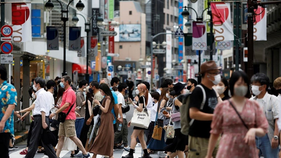 People walk at a crossing in Shibuya shopping area, amid the coronavirus disease (COVID-19) outbreak in Tokyo, Japan August 7, 2021. (Reuters)