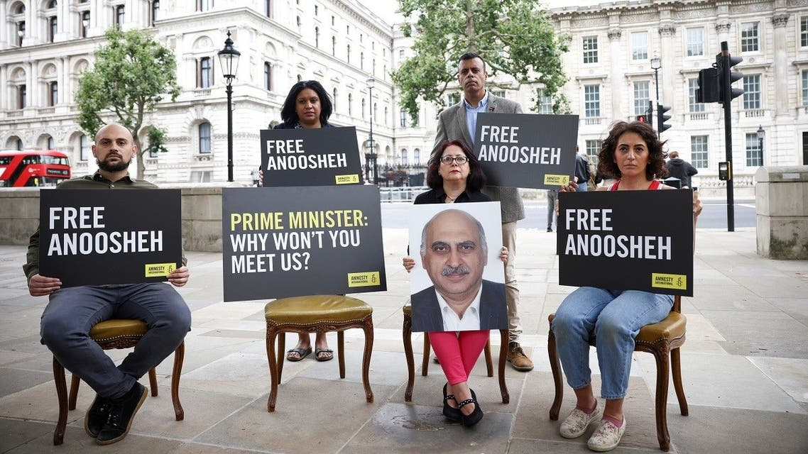 Sherry Izadi, Elika Ashoori and Aryan Ashoori, the family of Anoosheh Ashoori, a British man currently jailed in Iran, joined by Amnesty International CEO Sacha Deshmukh and MP Janet Daby, stage an 'empty chair' protest opposite Downing Street, on the 4th anniversary of his imprisonment, in London, Britain. (Reuters)