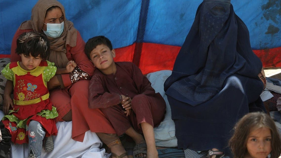 Internally displaced families from northern provinces, who fled from their homes due the fighting between Taliban and Afghan security forces, take shelter in a public park in Kabul, Afghanistan, on August 10, 2021. (Reuters)