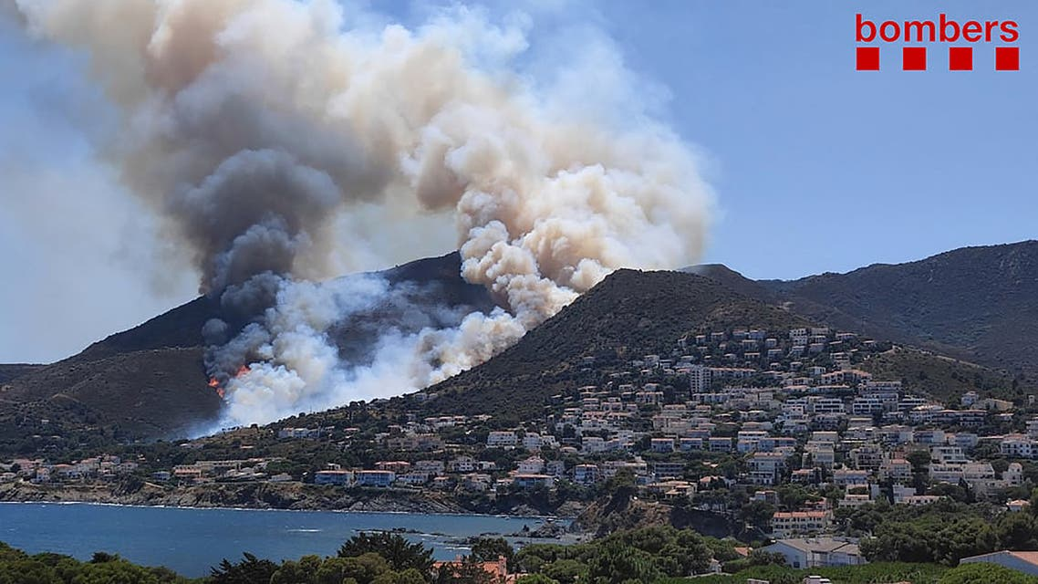 A handout picture released by Catalonia's firefighting squad (Bombers Generalitat Catalunya) shows smoke billowing from a fire raging near El Port de la Selva and Llanca close to the Cap de Creus Natural Park on July 16, 2021.(File photo: AFP)