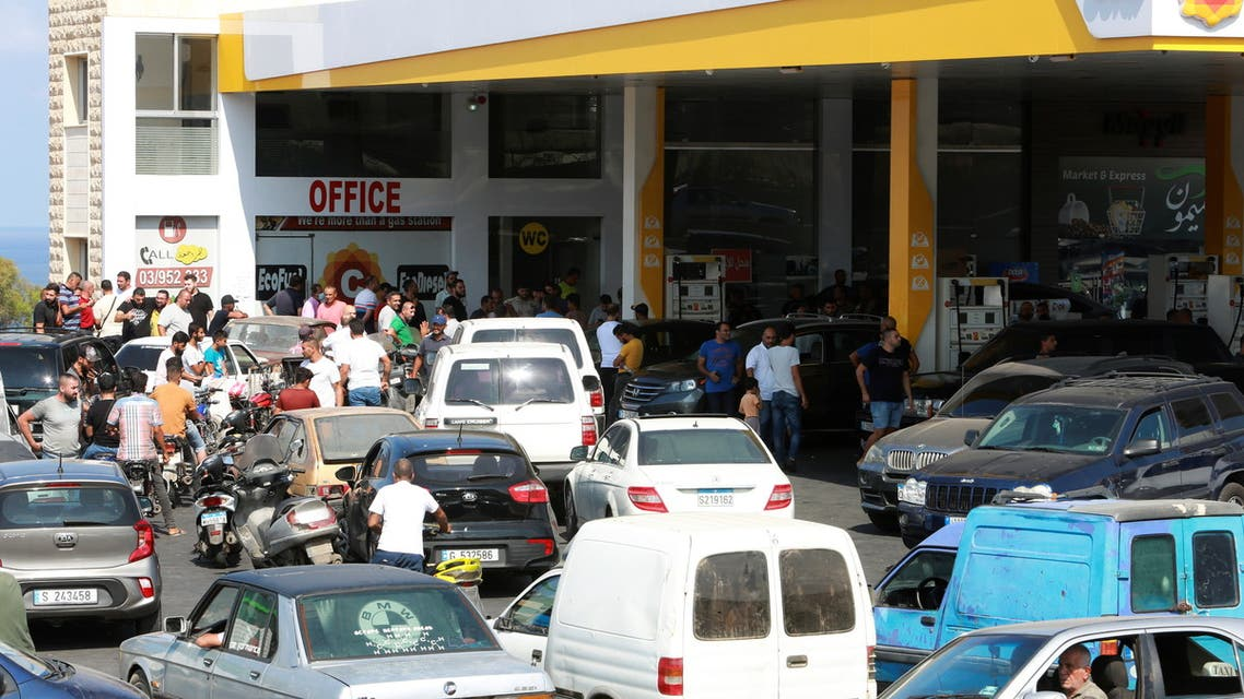 Motorbike and car drivers wait to get fuel at a gas station, after the central bank decided to effectively end subsidies on fuel imports, in Damour, Lebanon, August 13, 2021. (Reuters)