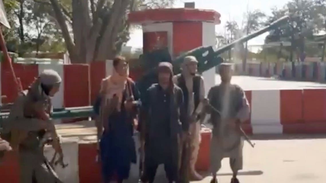 Taliban fighters gather on main road intersection in city of Ghazni, Afghanistan in this screen grab taken from a video released by the Taliban on August 12, 2021. (Reuters)