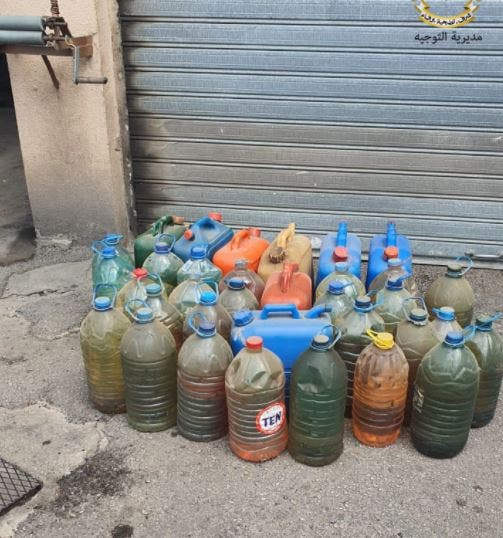 The Lebanese army seizes dozens of plastic cans stored with fuel at gas stations.  (Photo courtesy: The Armed Forces of Lebanon)