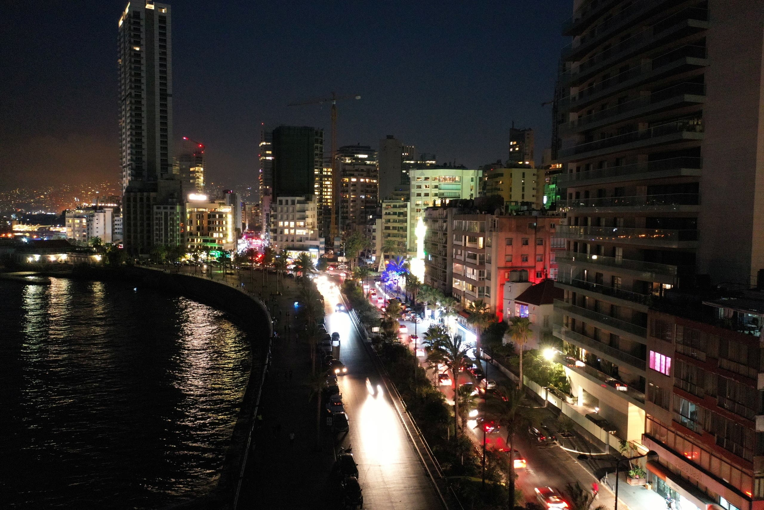 A view shows Beirut's seaside promenade Corniche in darkness during a partial blackout in Beirut, Lebanon August 10, 2021. (Reuters)