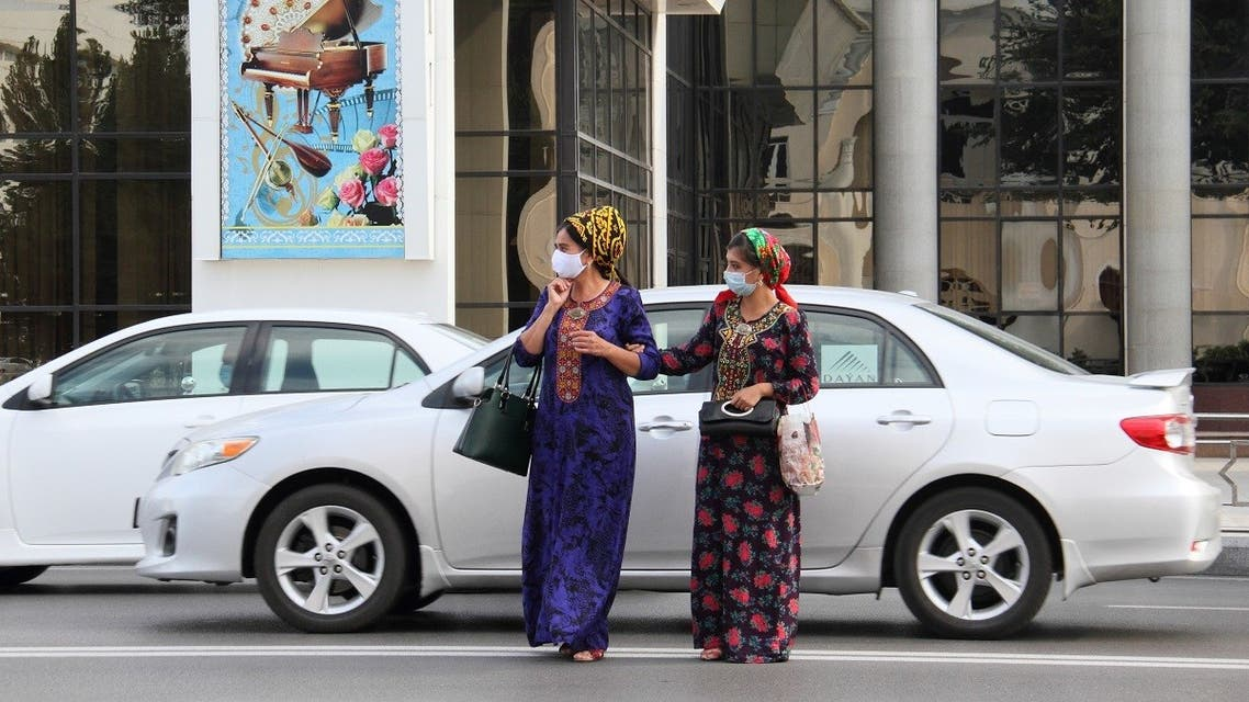 Women wearing protective face masks, used as a preventive measure against the spread of the coronavirus disease (COVID-19), cross a road in Ashgabat, Turkmenistan July 15, 2020. (Reuters)