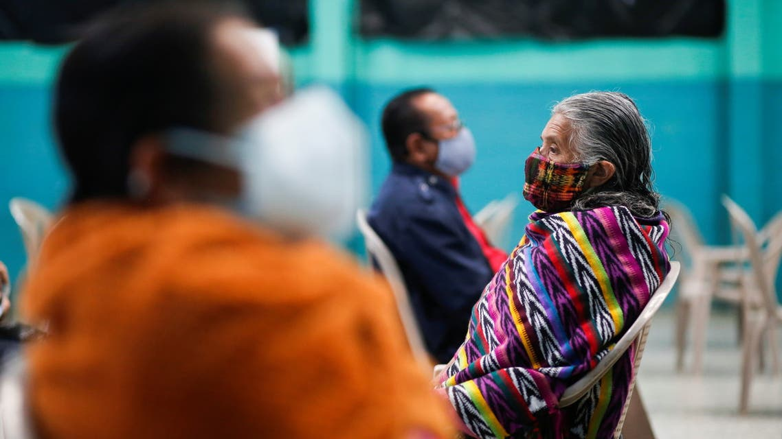 Mayan indigenous people wait their turn to receive Oxford/AstraZeneca vaccine against the coronavirus disease (COVID-19) at the municipal hall in San Pedro Sacatepequez, Guatemala May 6, 2021. (Reuters)