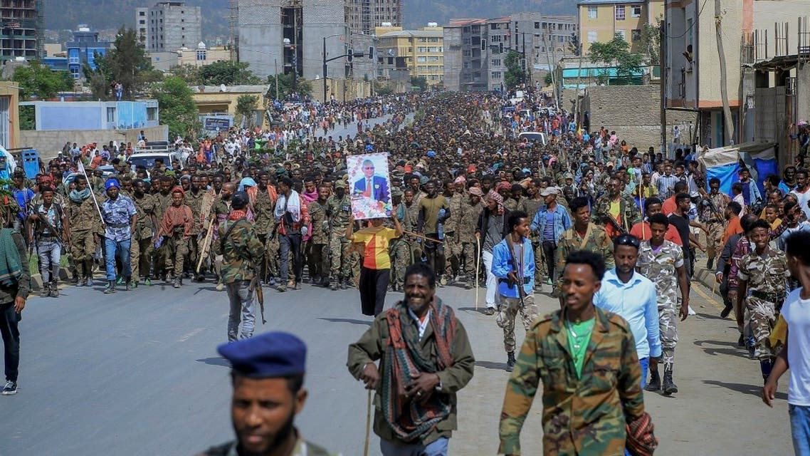 In this file photo on July 2, 2021, captured members of the Ethiopian National Defense Force are marched through the streets to prison under guard by Tigray Forces as hundreds of residents look on, in Mekele, in the Tigray region of northern Ethiopia.(AP)