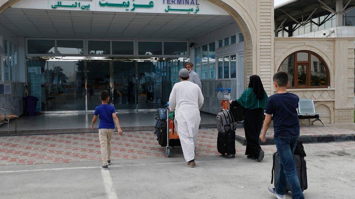 Passengers enter the departures terminal of Hamid Karzai International Airport, in Kabul, Afghanistan, Saturday, Aug. 14, 2021. (AP)
