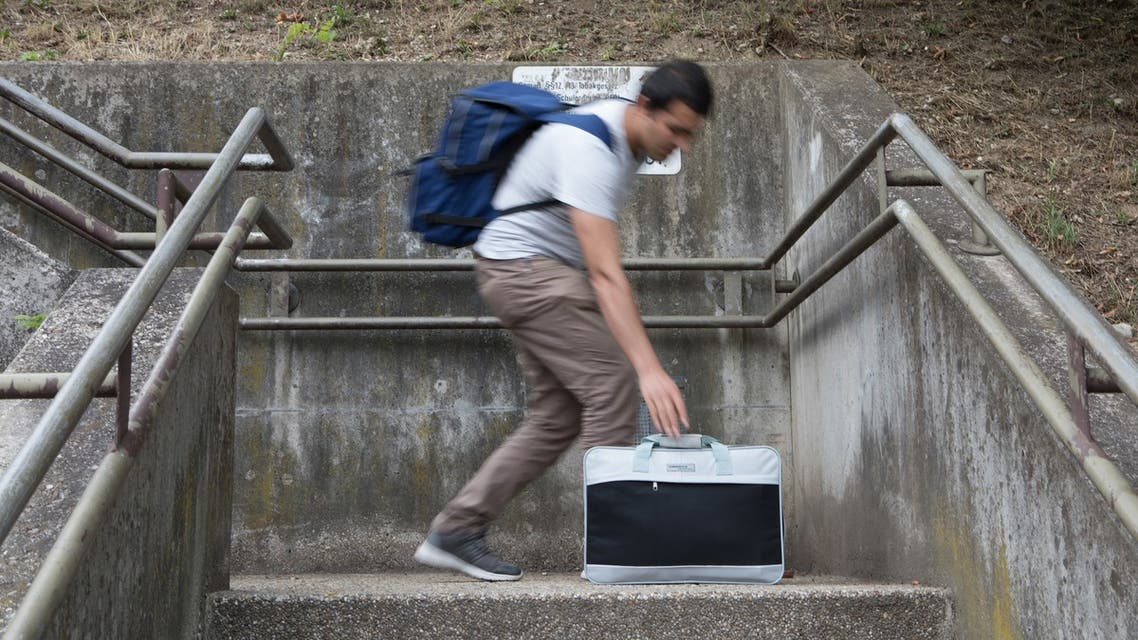 Afghan refugee Shafi carries his bag in front of the vocational school in Linz on June 15, 2018. From her small town in the north of Austria, Sylvia Hochstöger did not think of herself as the ambassador of a protest movement. It was the threat of expulsion of Shafi, the Afghan trainee apprentice in her company, that pushed her to fight against an absurd situation.