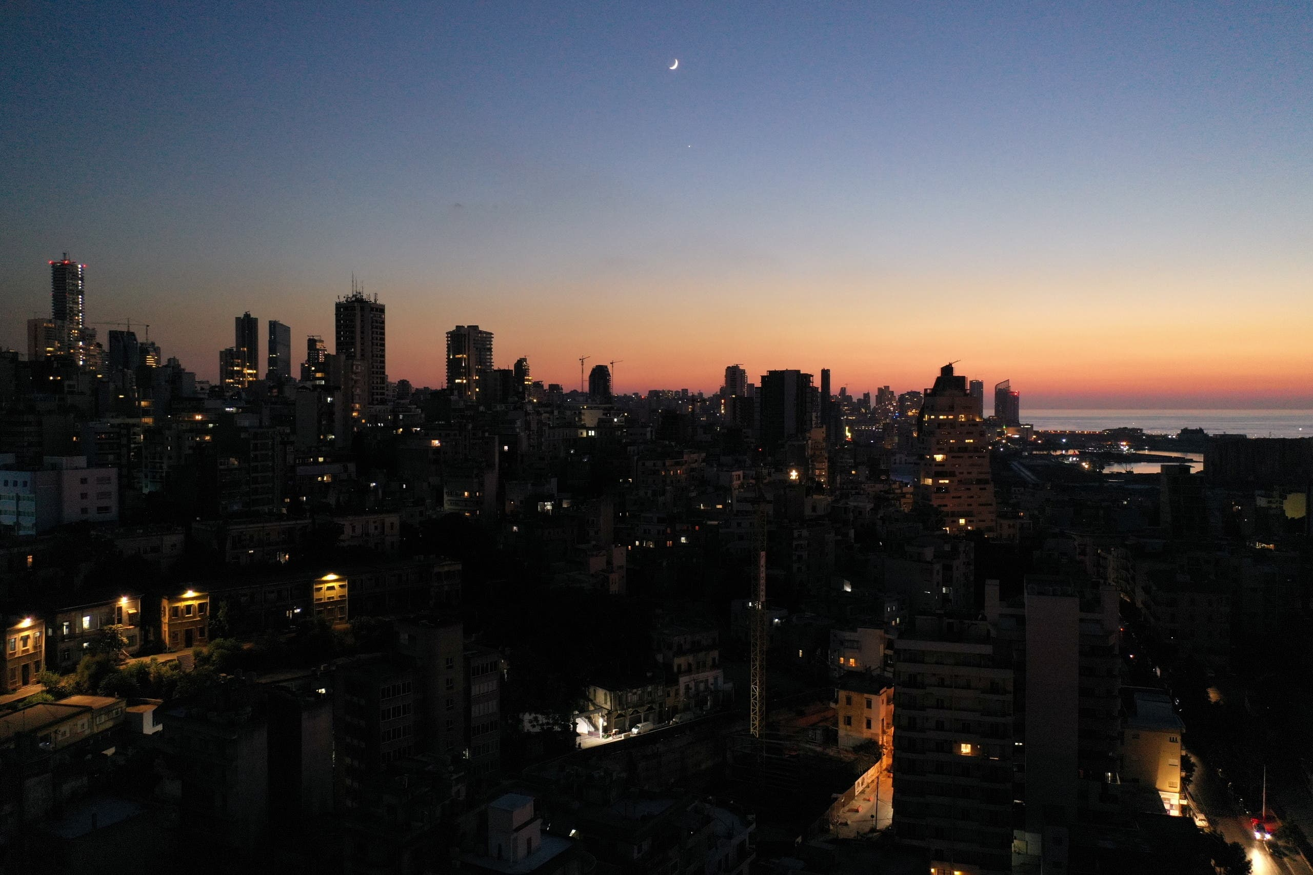 Unlit buildings are seen during a partial blackout in Beirut, Lebanon August 11, 2021. (File photo: Reuters)