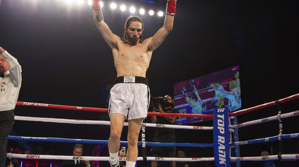 Nico Ali Walsh celebrates after defeating Jordan Weeks during a middleweight boxing bout Saturday, Aug. 14, 2021, near Tulsa, Okla. (AP)