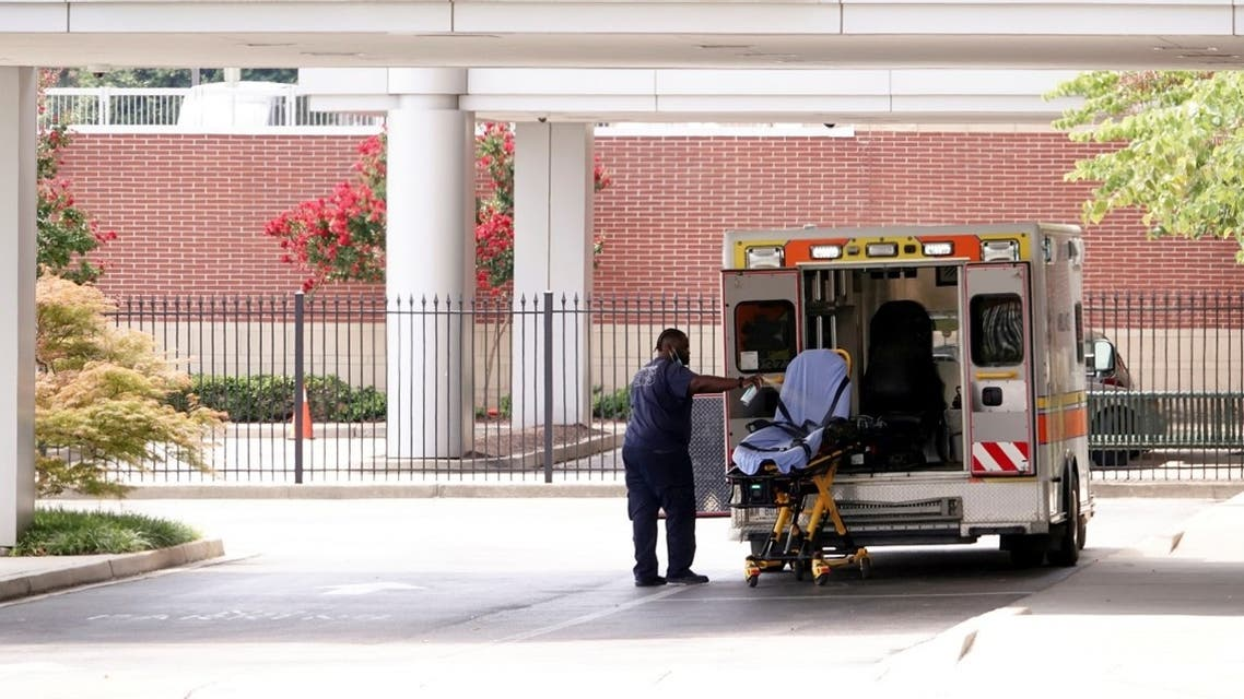 An ambulance driver disinfects a stretcher after unloading a patient at a Memphis children's hospital, in Memphis, Tennessee, US August 13, 2021. (Reuters/Karen Pulfer Focht)