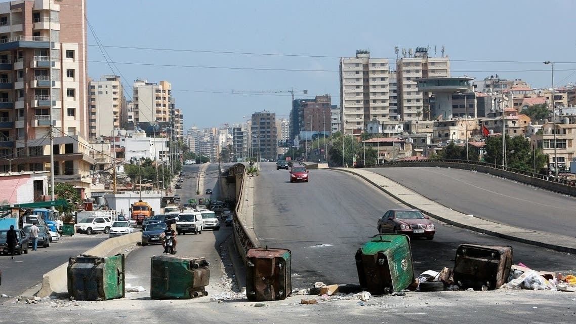 Garbage bins placed by protesters block a road, as fuel crisis worsens, in Beirut, Lebanon August 14, 2021.  (Reuters)