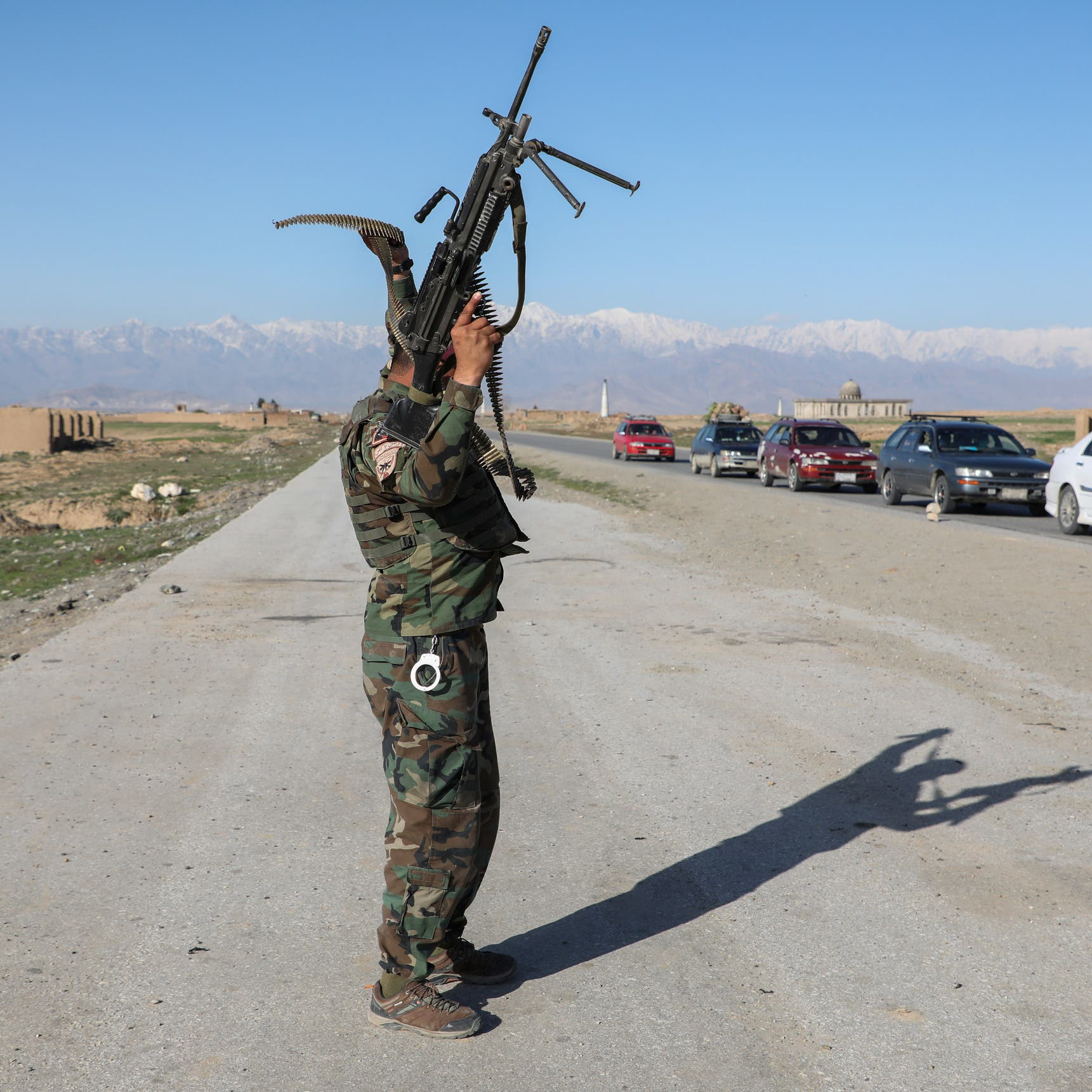 Afghan official says forces surrender Bagram air base to Taliban