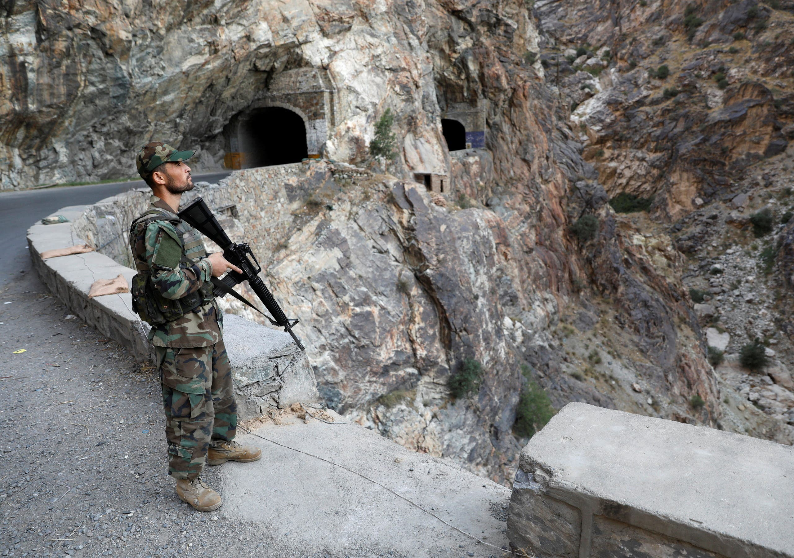 An Afghan National Army soldier stands guard at the check post at Mahipar, on Jalalabad-Kabul highway Afghanistan July 8, 2021. (Reuters)