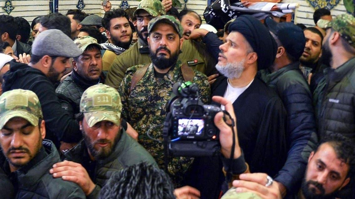 Qais al-Khazali (C) commander of the Asaib Ahl al-Haq pro-Iran faction attends the funeral procession of slain Iraqi paramilitary chief Abu Mahdi al-Muhandis, at the Imam Ali Shrine in the shrine city of Najaf in central Iraq on January 4, 2020. (Haidar Hamdani/AFP)