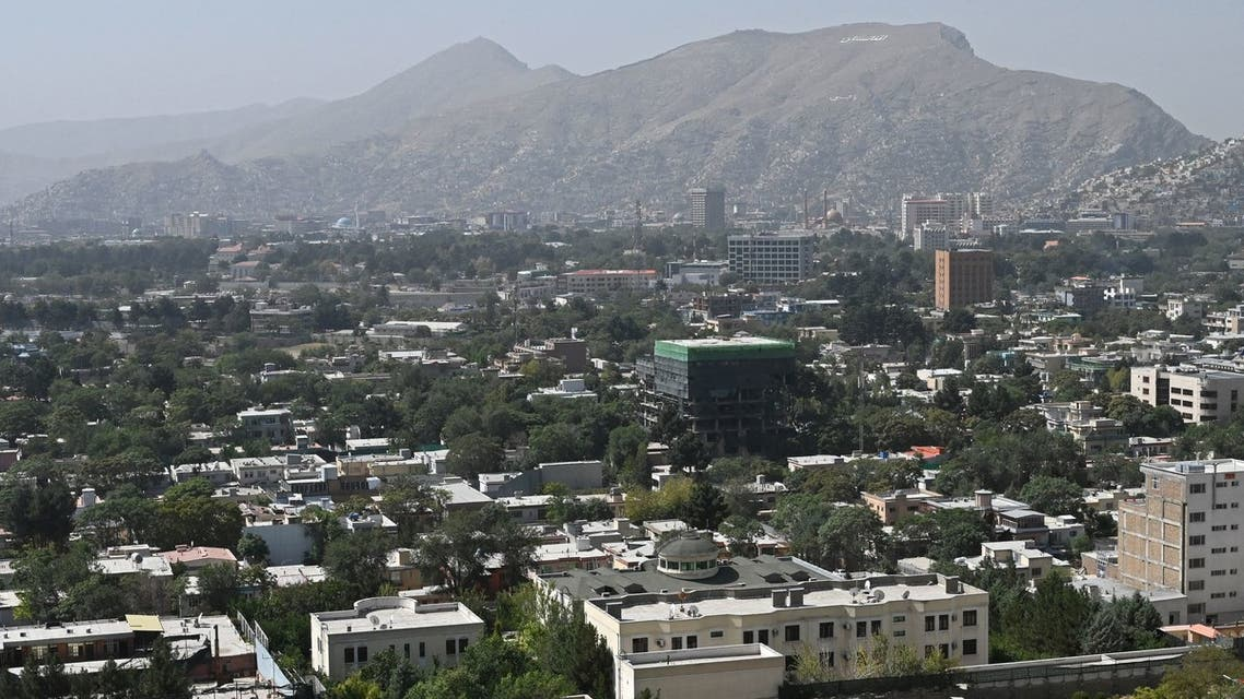 This picture taken from the top of a hillside shows a general view of the Kabul city on August 15, 2021. (AFP)