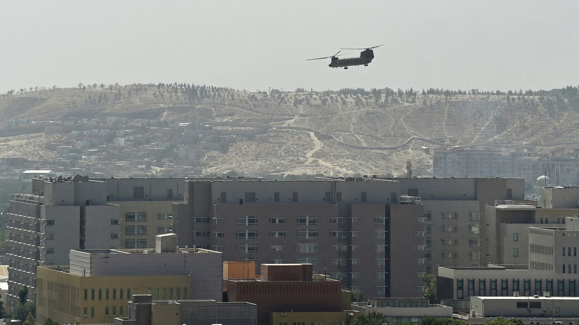 A US military helicopter is pictured flying above the US embassy in Kabul on August 15, 2021. (AFP)