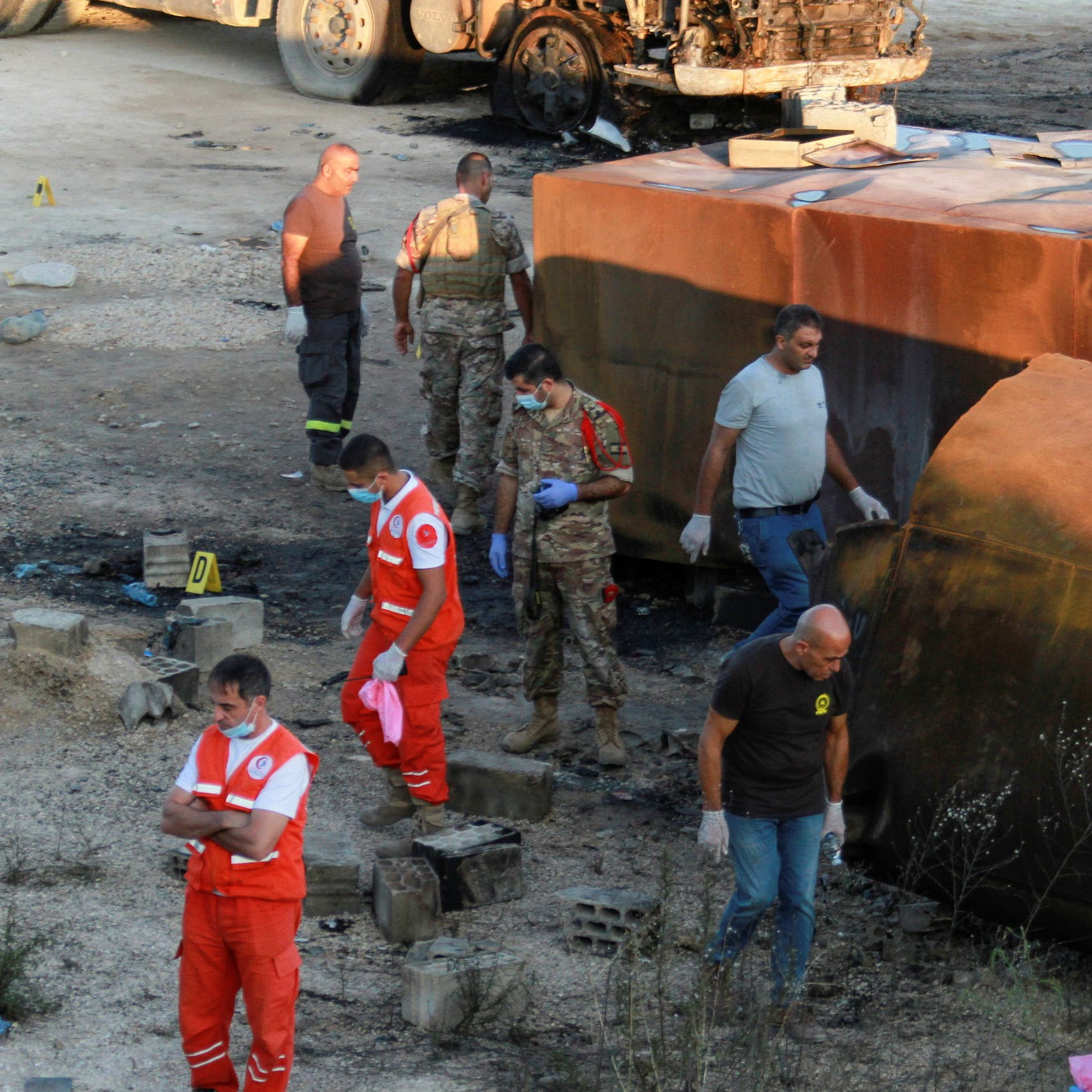 Gunfire or ignited lighter may have caused Lebanon fuel tanker explosion, 28 killed