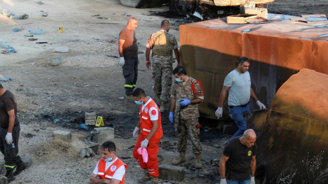 Lebanese army soldiers, civil defense members and rescuers are seen at the site of a fuel tanker explosion in Akkar, in northern Lebanon, August 15, 2021. (Reuters)