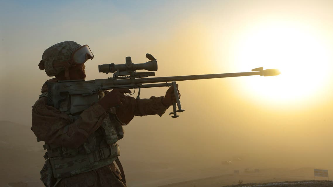 A Russian soldier looks through his sniper's rifle during a joint military drills by Russia, Tajikistan and Uzbekistan at Harb-Maidon firing range about 20 kilometers (about 12 miles) north of the Tajik border with Afghanistan, in Tajikistan, Tuesday, Aug. 10, 2021. (AP)
