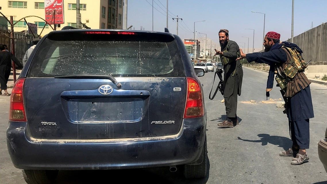 Members of Taliban forces gesture as they check a vehicle on a street in Kabul, Afghanistan, August 16, 2021. (Reuters/Stringer)