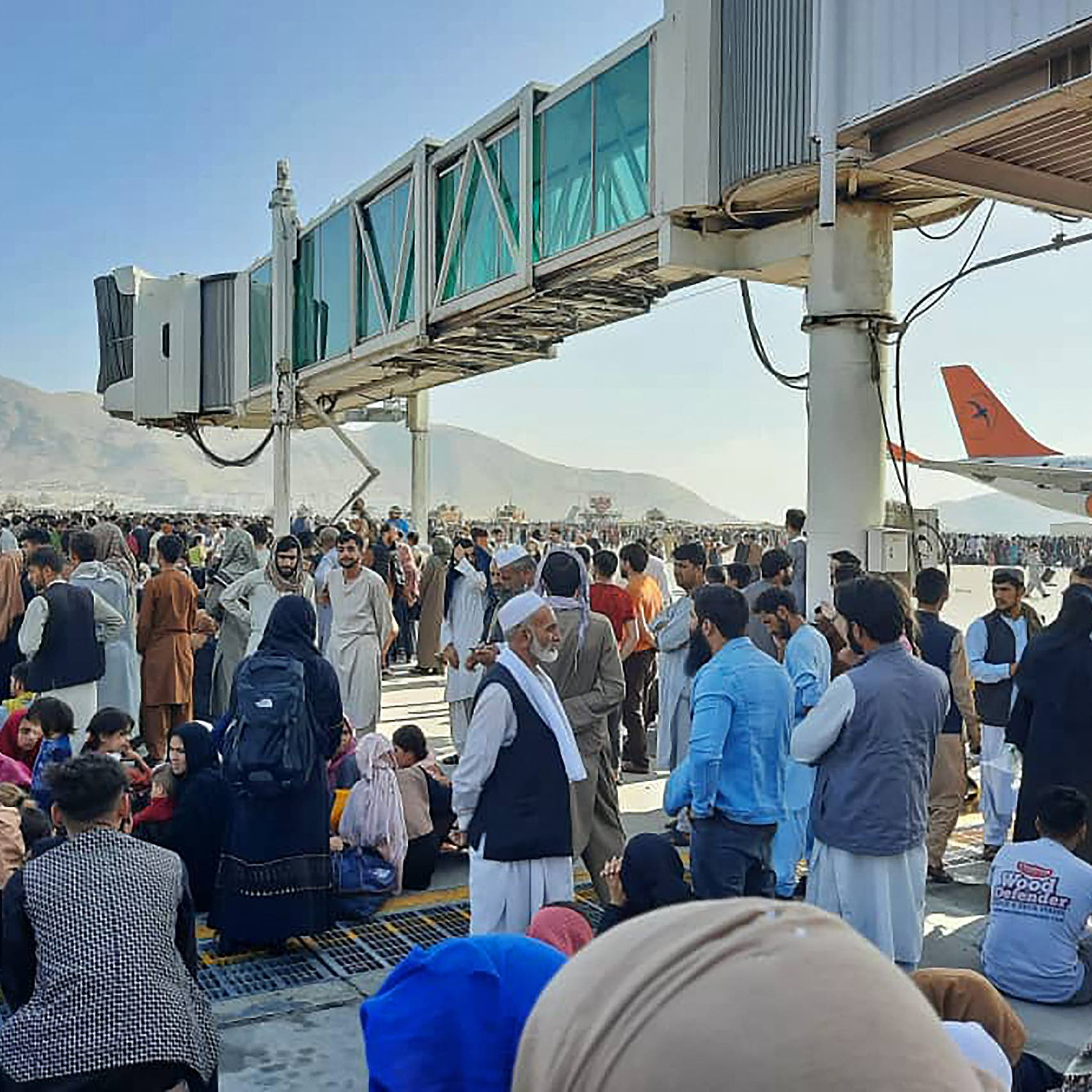 At least seven killed at Kabul airport as Afghans try to flee Taliban takeover