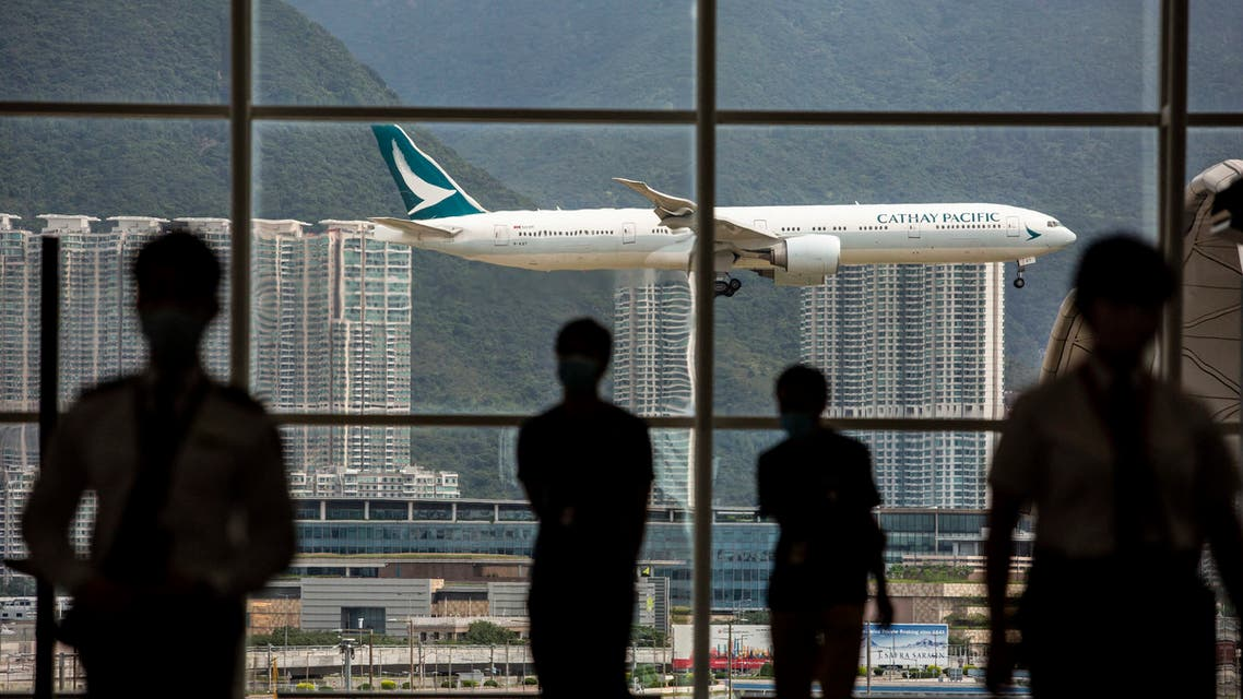 A Cathay Pacific aircraft comes in to land at Hong Kong International Airport on August 11, 2021. (AFP)