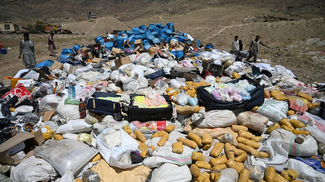 Daily workers and security forces prepare to set on fire a pile of narcotics during the National Mobilization Week against Drug Abuse and Illicit Trafficking, in the Deh Sabz district of Kabul on July 1, 2021. (File photo: AFP)