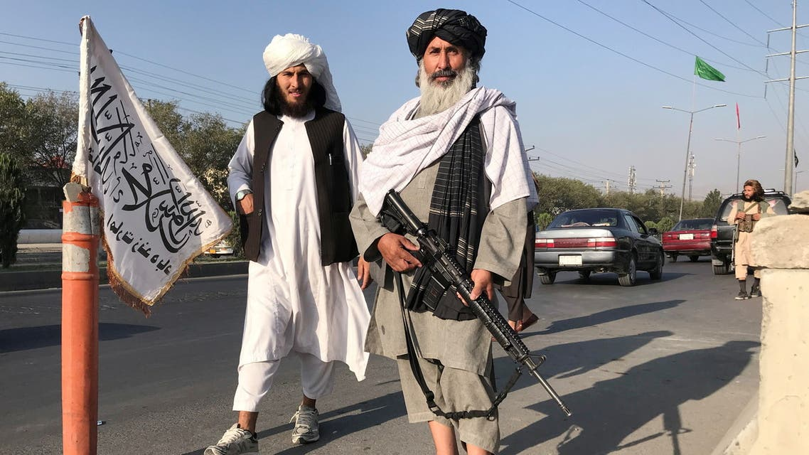 Taliban fighters stand outside the Interior Ministry in Kabul, Afghanistan, August 16, 2021. (Reuters)