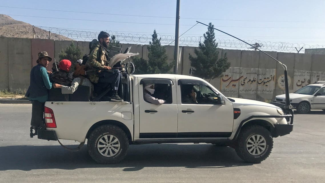 Taliban fighters ride on a vehicle in Kabul, Afghanistan, August 16, 2021. (Reuters)