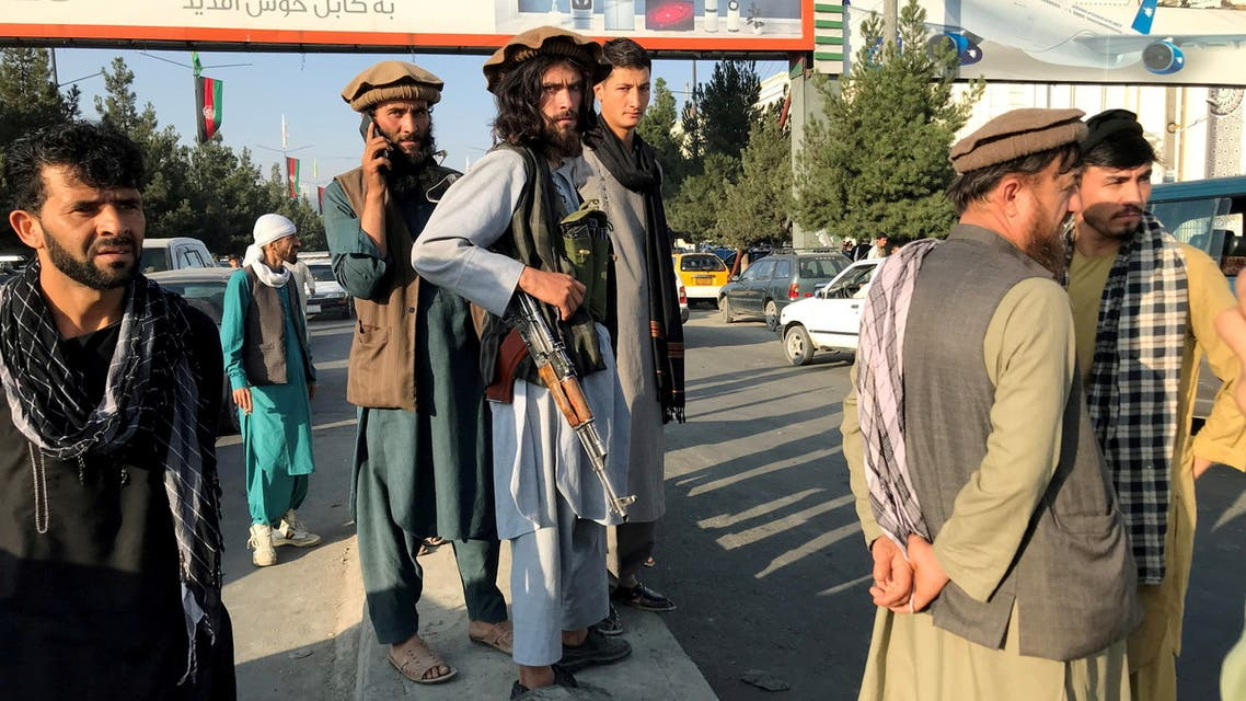 A member of Taliban (C) stands outside Hamid Karzai International Airport in Kabul, Afghanistan, August 16, 2021. (Reuters)