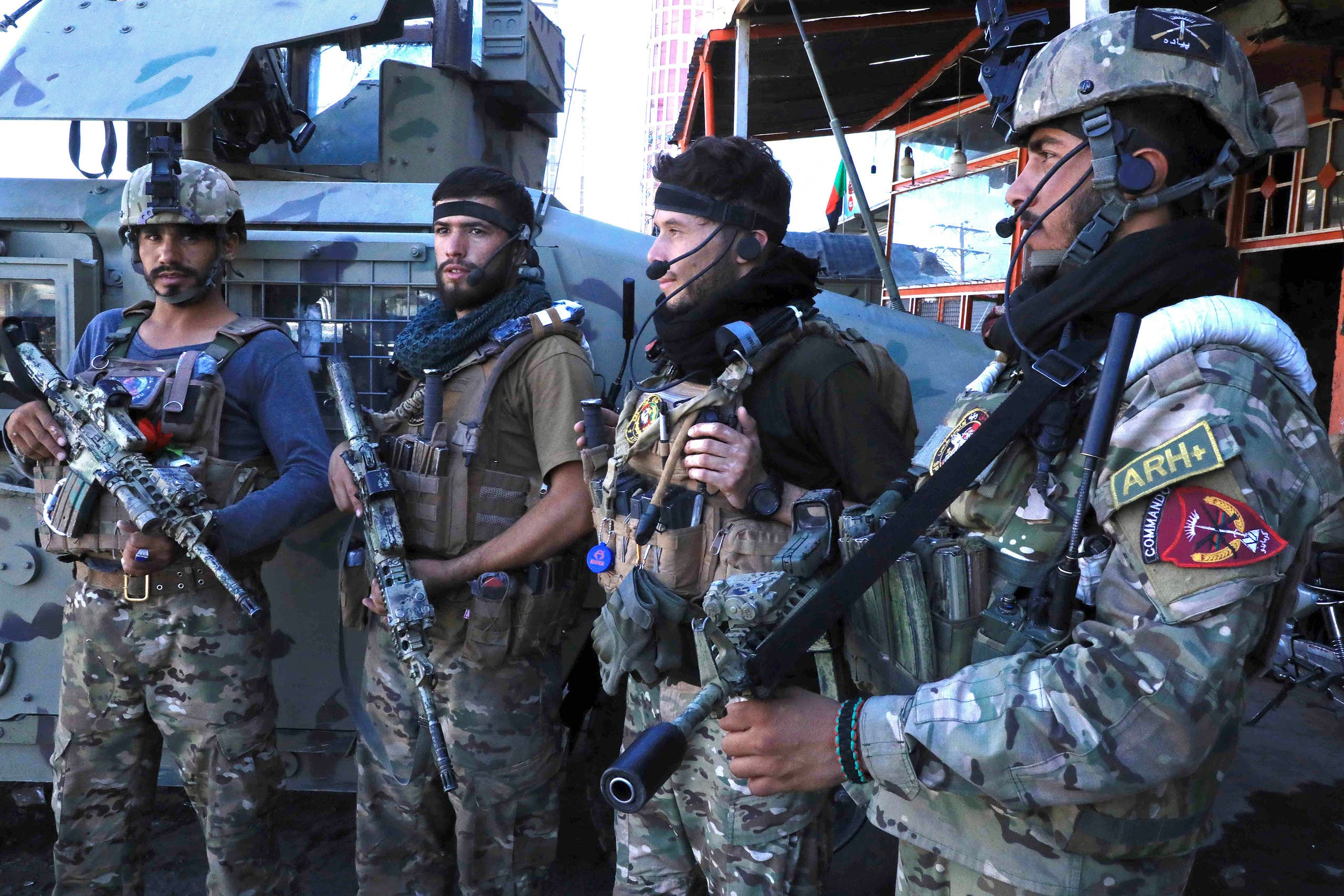 Afghan security force personnel stand guard along the roadside in Herat on August 12, 2021, as Taliban took over the police headquarters in Herat, Afghanistan's third-largest city and also seized another key district capital just 150 kilometres (95 miles) from capital Kabul. (File photo: AFP)