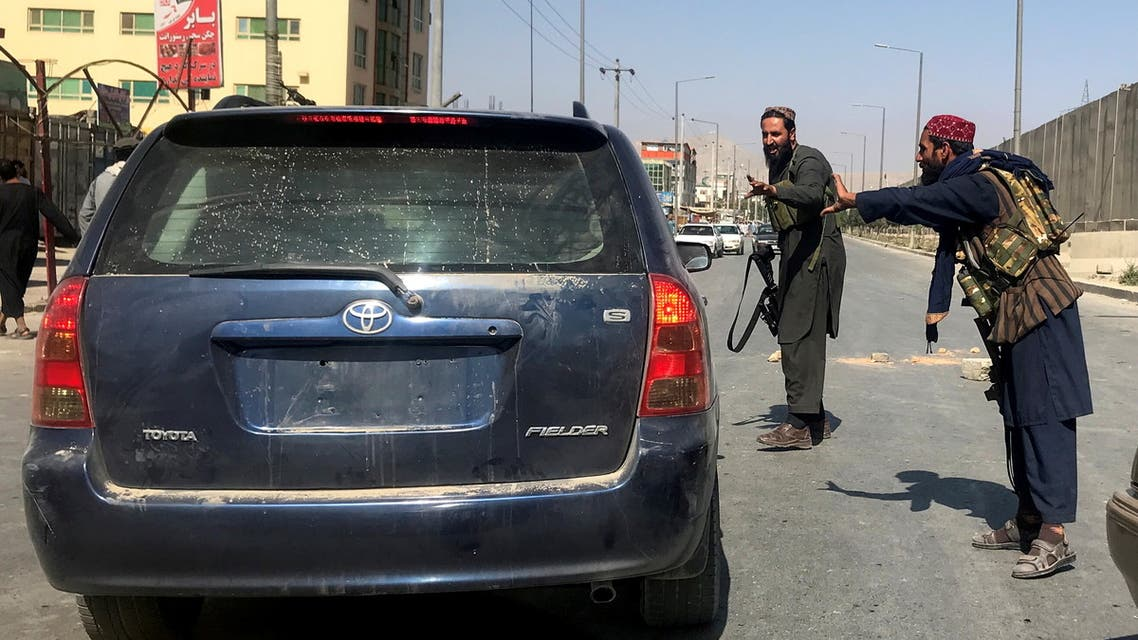 Members of Taliban forces gesture as they check a vehicle on a street in Kabul, Afghanistan, August 16, 2021. (Reuters)