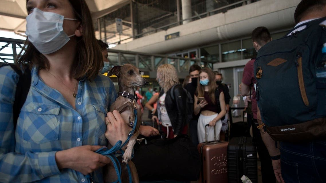 Tourists arrive at Malaga-Costa del Sol Airport on June 7, 2021 in Malaga, Spain.  (AFP)