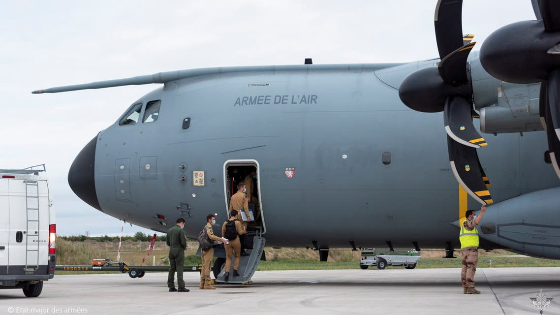 French army members board a French Air Force Airbus A400M ATLAS ahead of an operation to evacuate several dozen French citizens from Afghanistan, August 16, 2021. (Reuters)