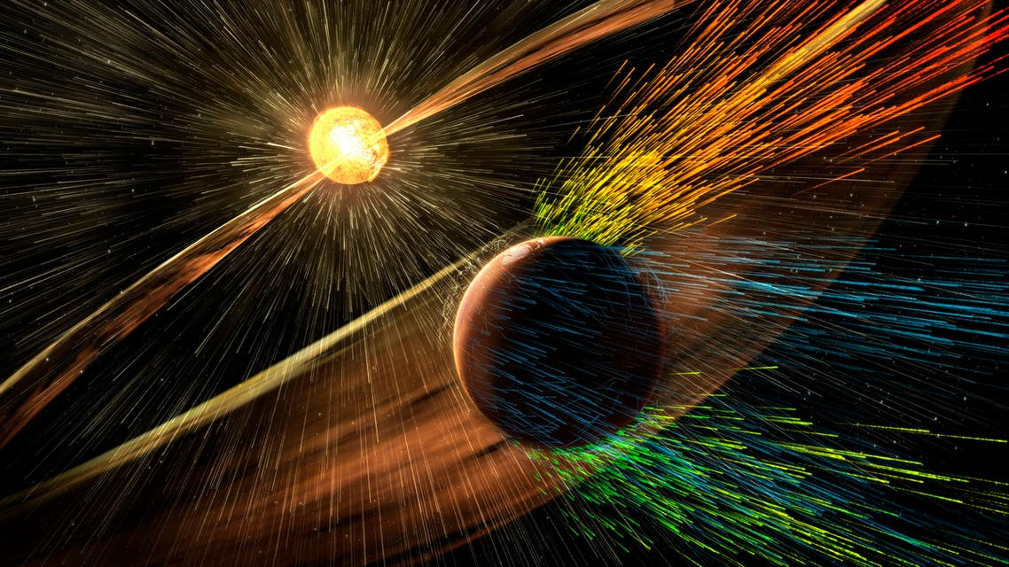 An undated artist's rendering depicts a solar storm hitting Mars and stripping ions from the planet's upper atmosphere in this NASA handout released November 5, 2015. (Reuters)